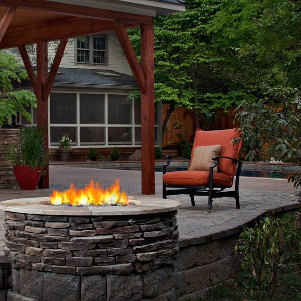Natural Stone Fire Pit Warms Charlotte Patio | Archadeck Outdoor Living