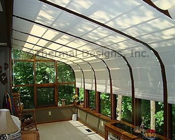 Screen shades in curved Four Seasons sunroom.   Sunroom Shades in