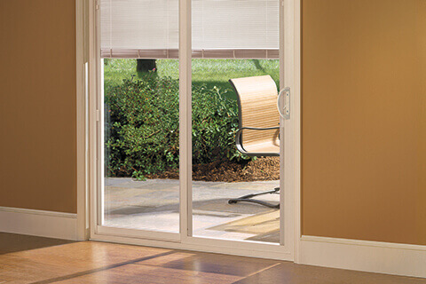 The advantages of sliding doors with built in blinds - Pella Branch