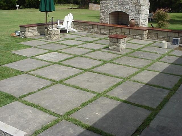 I like this idea of square concrete slabs for patio - might not be
