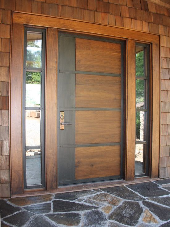 Contemporary front door of stained wood and rolled steel | Home