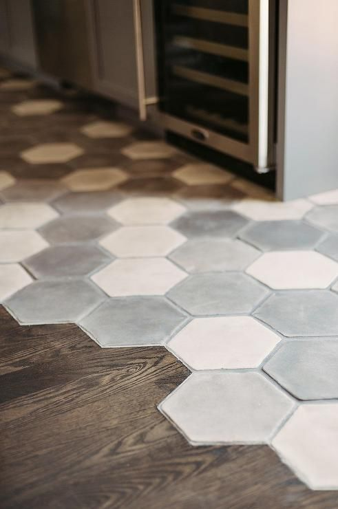 Fantastic gray kitchen features a white and gray hex concrete tiled