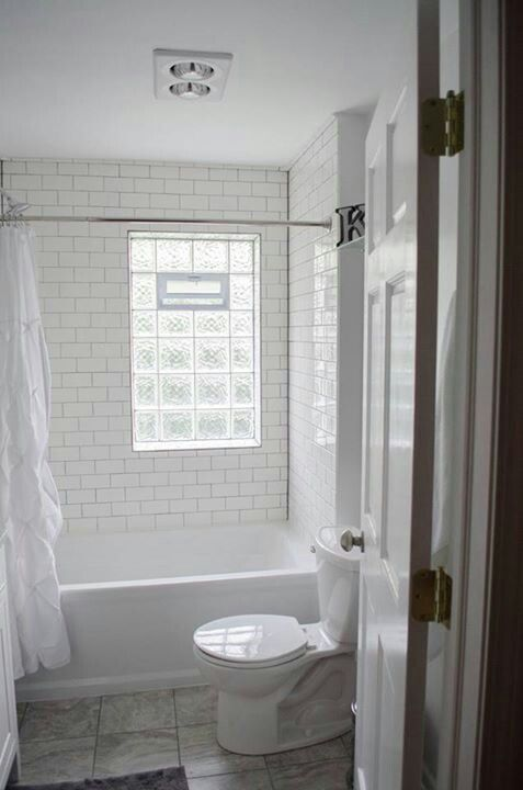 We remodeled! White subway tile, gray grout, glass block window