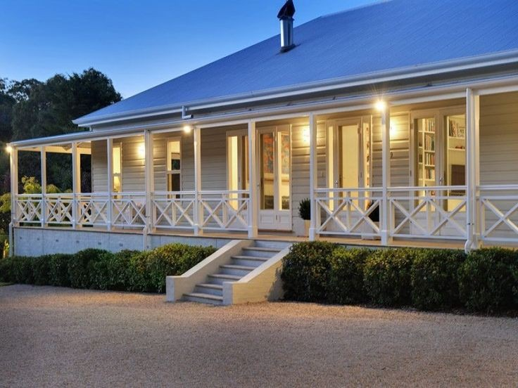 modern farmhouse balcony metal exterior lighting | Colin Timberlake
