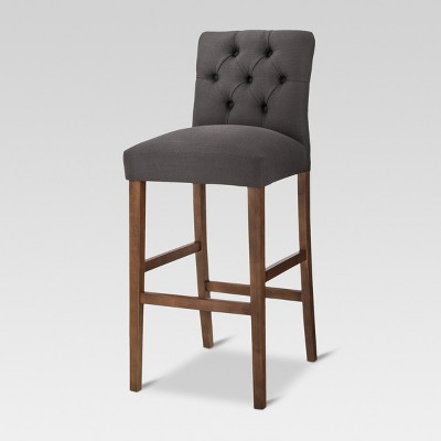 You sit comfortably on the barstool!