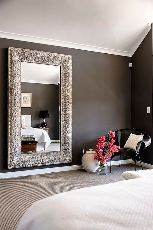 This is absolutely stunning! the mirror, the flowers, the dark wall
