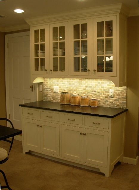 Hang top of buffet on wall, tile behind the shelves, cover top of