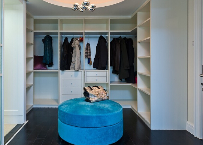 Open wardrobe and a blue circle stool | Interior Design