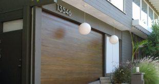 Uneven Threshold Garage Floor With a Custom-Made Garage Door by