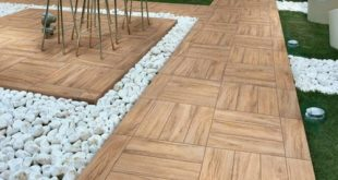 Laying wooden tiles - wooden floor on the balcony