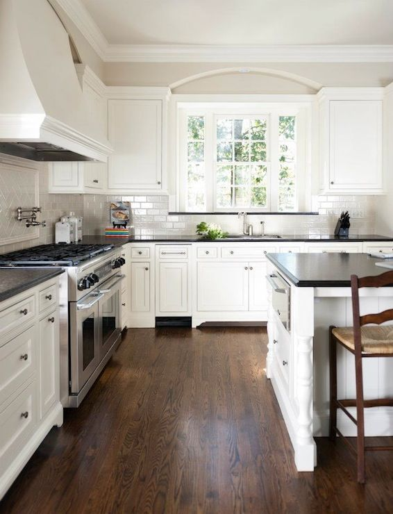 Love the dark wood, white cabinets, and grey tile | For the Home in
