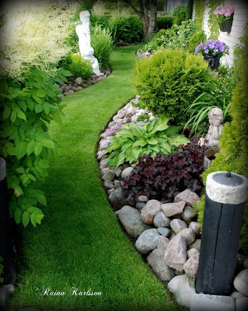 beautiful curved flower bed with rock garden and plantings that add