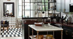 Glass partition between kitchen and the living room. | Kitchen