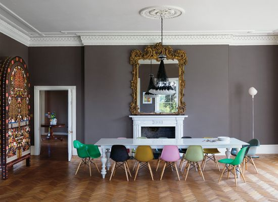 Grey Wall and multicolored chairs. Design by Ilse Crawford. | Dining