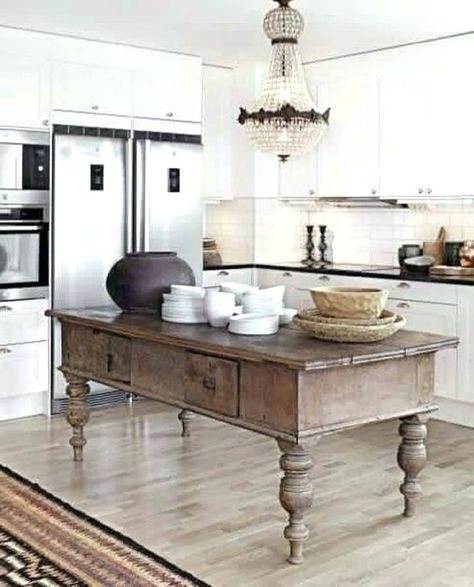 Modern white kitchen with antique rustic wood island. french country