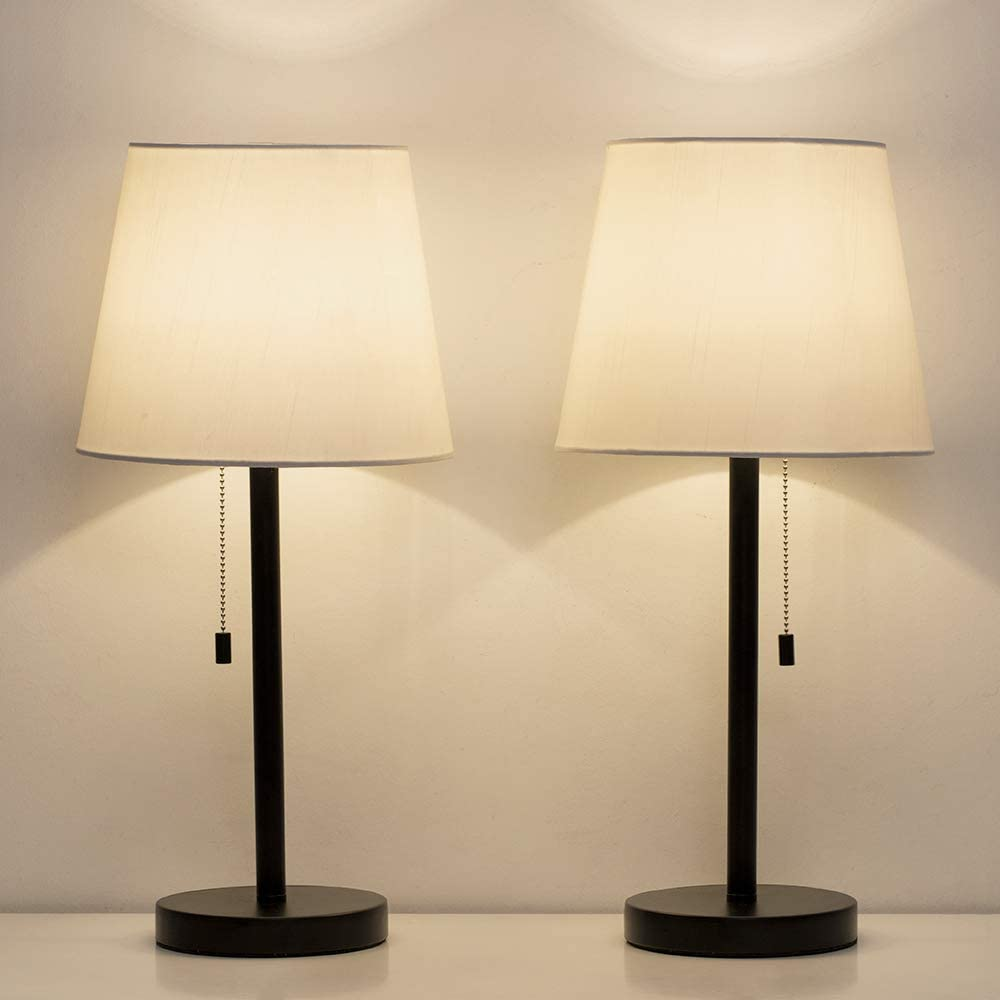 Bedside table with lamps