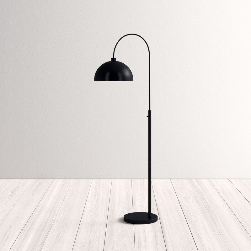 Innovation and creativity with a black arched floor lamp